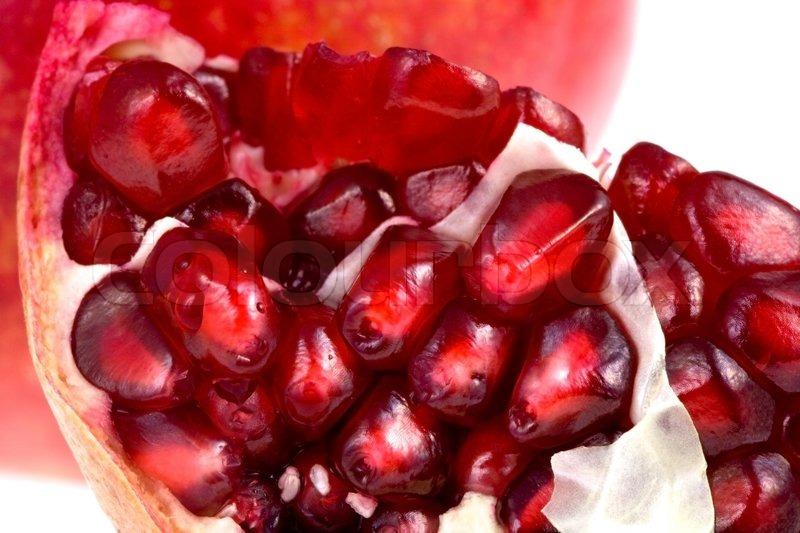 Broken pomegranate close up | Stock Photo | Colourbox