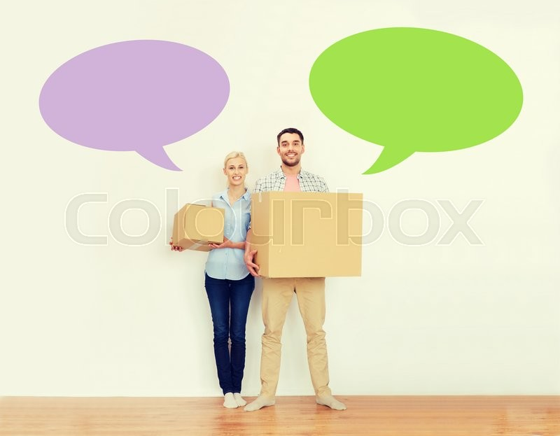 Stock image of 'home, people, repair and real estate concept - happy couple holding cardboard boxes and moving to new place with empty blank text bubbles'