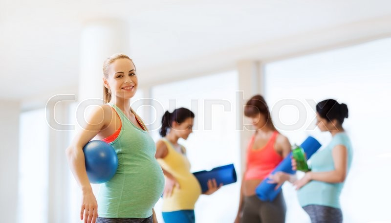 Stock image of 'pregnancy, sport, fitness, people and healthy lifestyle concept - happy pregnant woman with ball in gym'