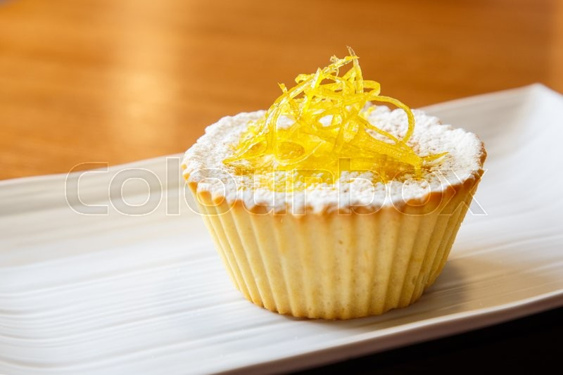 Stock image of 'Custard cake  decorated with sugar powder and  candied fruits '