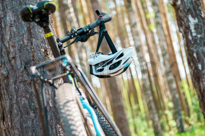 Stock image of 'Cycling helmet closeup on bicycle outdoors'