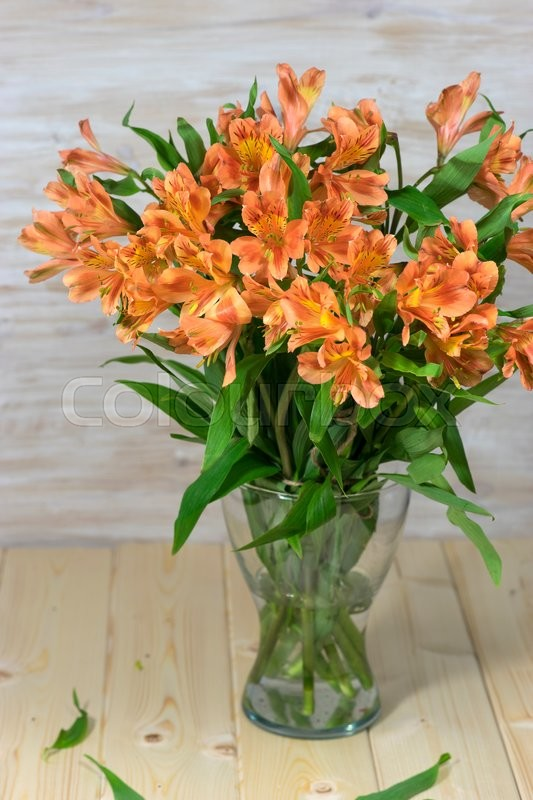 Stock image of 'Bunch of beautiful alstroemeria flowers on wooden rustic background'