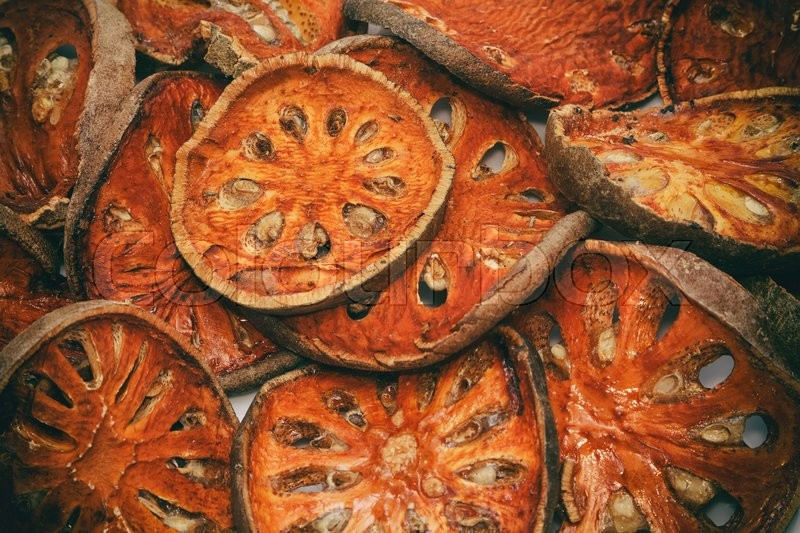 Stock image of 'Close up slices of dried bael fruit'