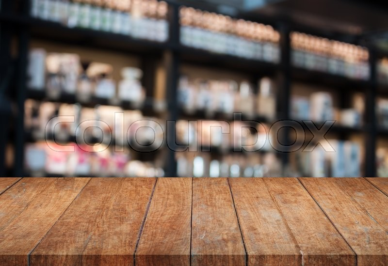Perspective top wooden table with blurred cafe background product