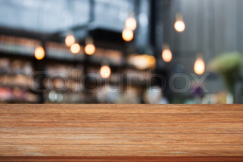 Stock image of 'Top wooden table with cafe background, stock photo'