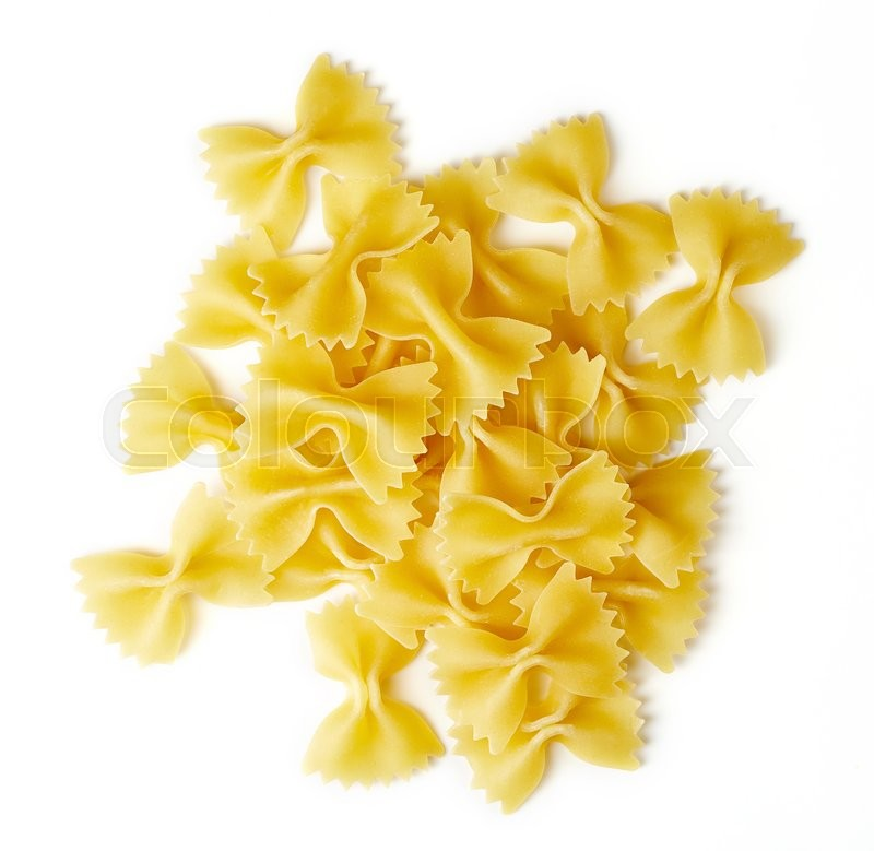 Stock image of 'bow tie pasta isolated on white background, top view'