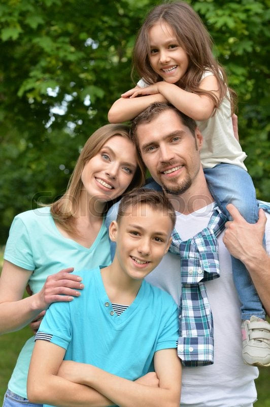 Stock image of 'Portrait of a happy family in park'