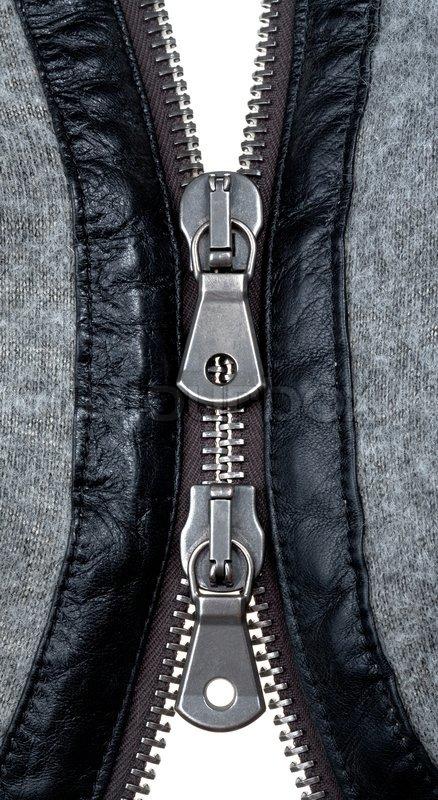 Metal double zipper lock in unzip wool jacket. close-up ...