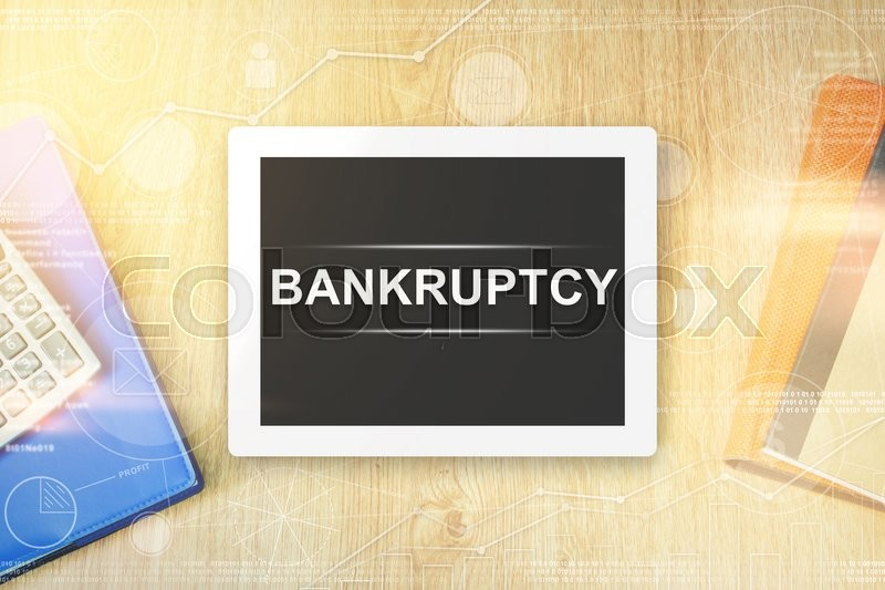 Stock image of 'bankruptcy word on tablet with soft light vintage effect'