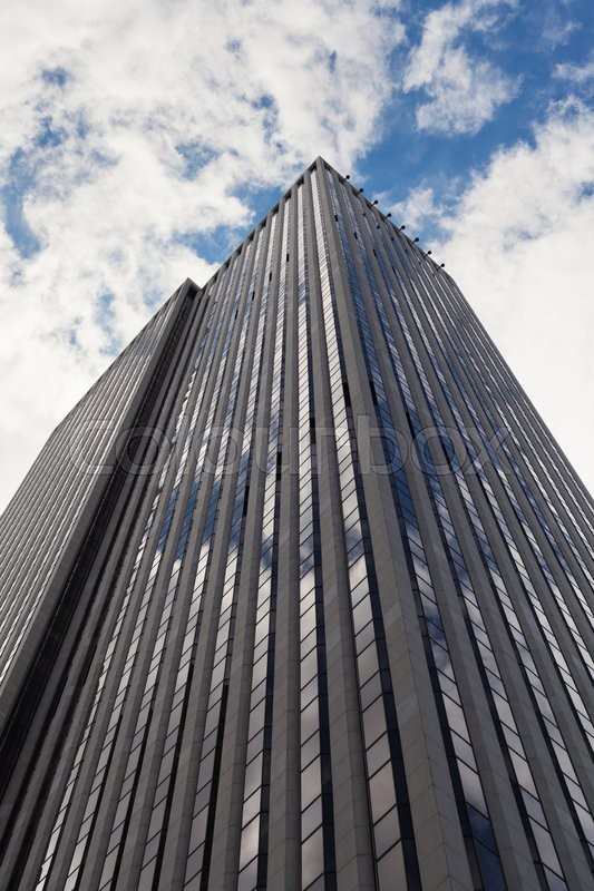 Stock image of 'Low angle view of a skyscraper in Manhattan, New York City.'