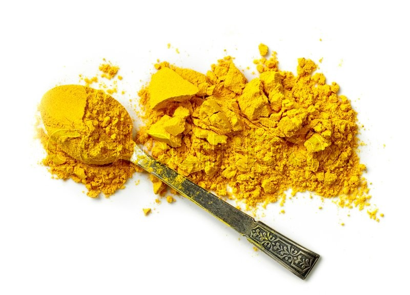 Stock image of 'heap of curcuma powder isolated on white background, top view'