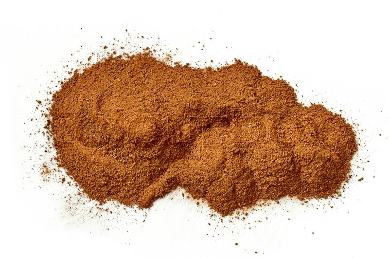 Stock image of 'heap of ground cinnamon isolated on white background, top view'