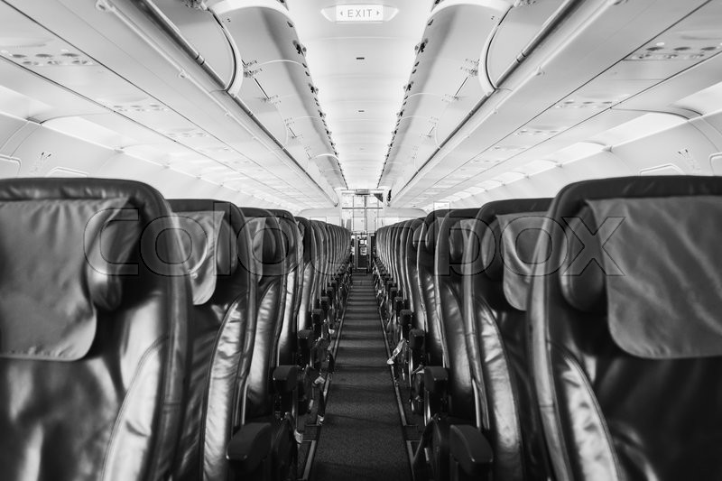 Black And White Photo Of Airplane Seat Inside An Aircraft