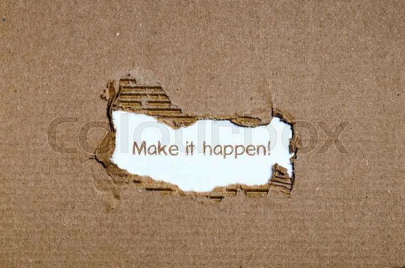 Stock image of 'The word make it happen appearing behind torn paper.'