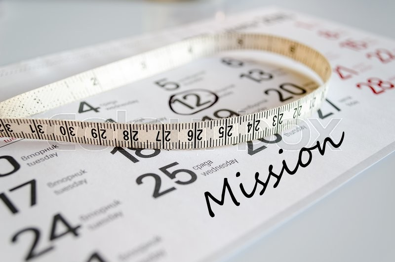 Stock image of 'Mission text concept over tape measure and calendar background\\  '