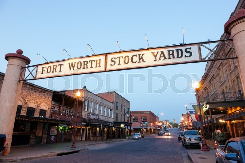 Editorial image of 'FORT WORTH, TX, USA - APR 6: Street in the Fort Worth Stockyards district illuminated at dusk. April 6, 2016 in Fort Worth, Texas, USA'