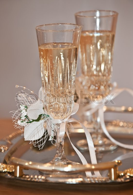 Wedding glasses  Glasses with a champagne decorated decorative flower Stock Photo Colourbox