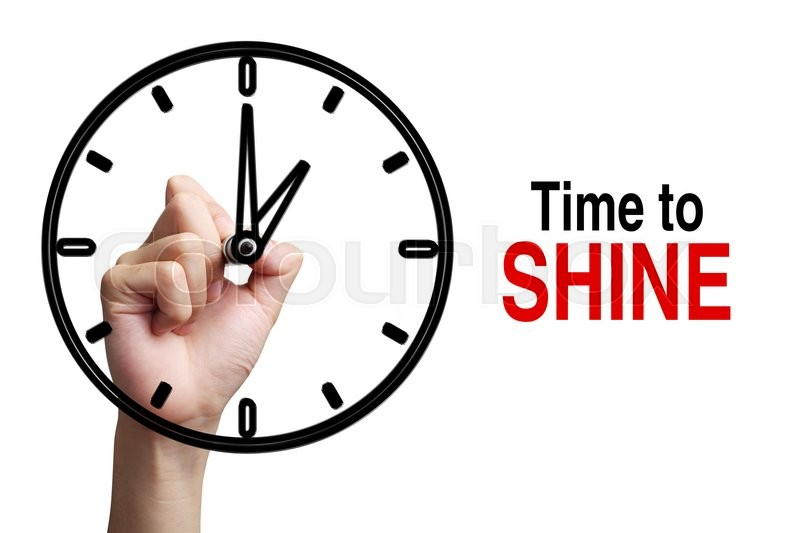 Stock image of 'Hand is drawing a clock with text Time To Shine Concept aside isolated on white background.'