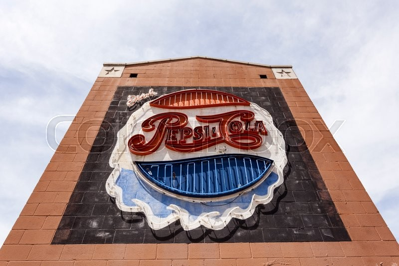 Editorial image of 'DALLAS, USA - APR 7: Old Pepsi Cola commercial neon sign in the city of Dallas. April 7, 2016 in Dallas, Texas, United States'