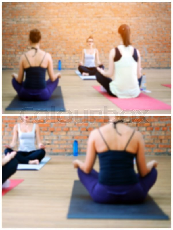 Stock image of 'Cropped and blurred images of young women doing yoga indoors. Group workout in yoga studio'