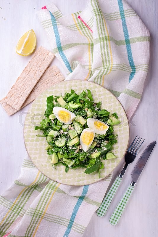 Stock image of 'Fresh green salad with spinach, avocado, cucumner, eggs'