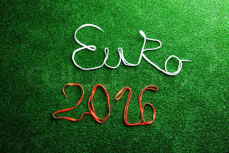 Stock image of 'Euro 2016 sign made of shoelaces against artificial turf, studio shot on green background.'