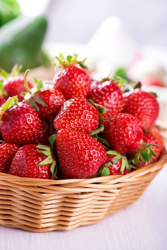 Stock image of 'Fresh strawberries harvest in the basket'