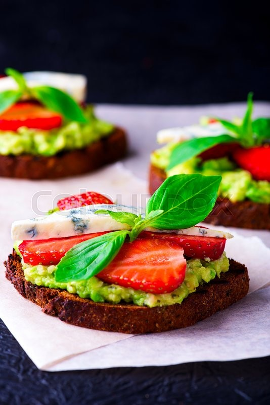 Stock image of 'Sandwich with strawberry on white craft paper'