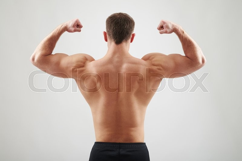 Stock image of 'Back of sexy young athletic man who is showing muscles isolated on white background'