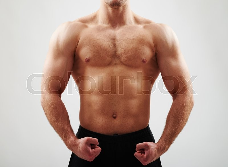 Stock image of 'Close-up of bare sexy strong athletic male torso on white background'