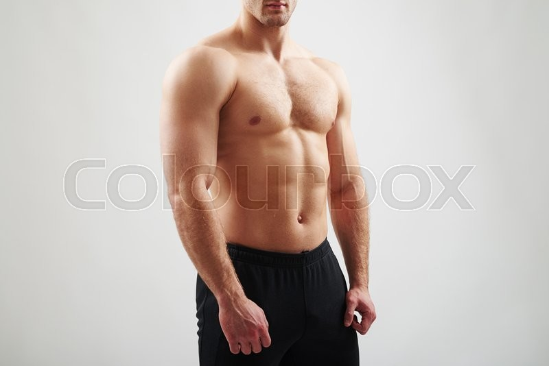 Stock image of 'Muscular bare torso of sexy athletic guy on white background'