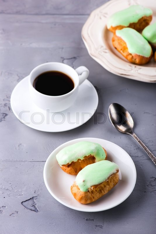 Stock image of 'Breakfast with mint eclairs and cup of coffee'