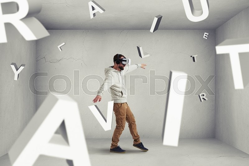 Stock image of 'Man in virtual reality glasses is stepping carefully between flying letters composing word combination \