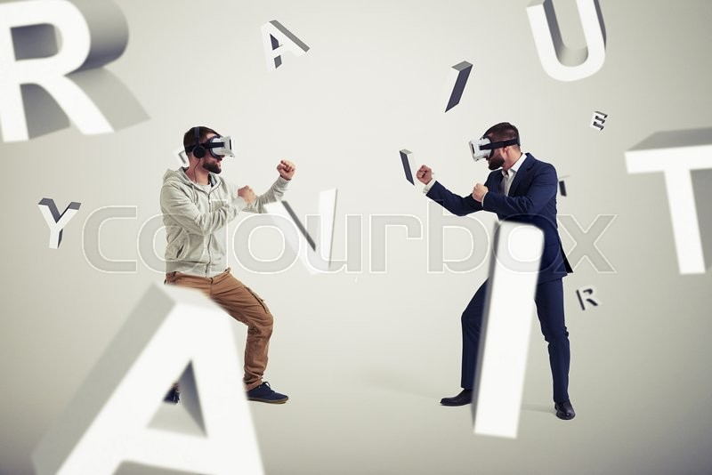 Stock image of 'Two men, one in casual clothes, another in dark business suit, are wearing virtual reality glasses and standing in fighting poses ready to start their combat in virtual reality surrounded by flying letters '