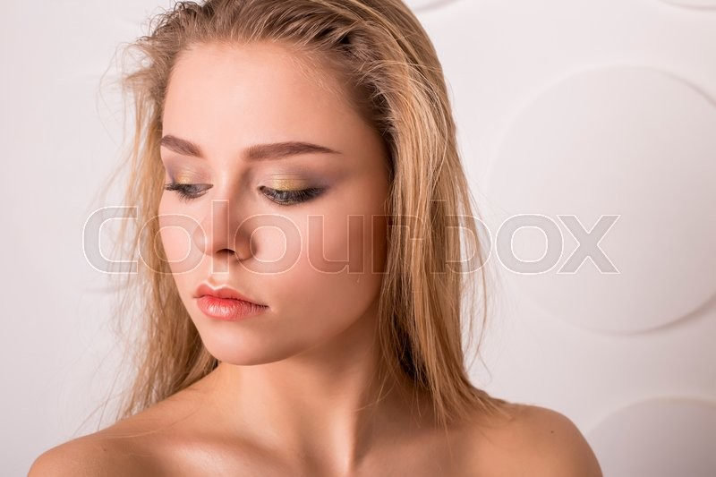 Stock image of 'Lady with natural make-up and blonde hair studio fashion shot'