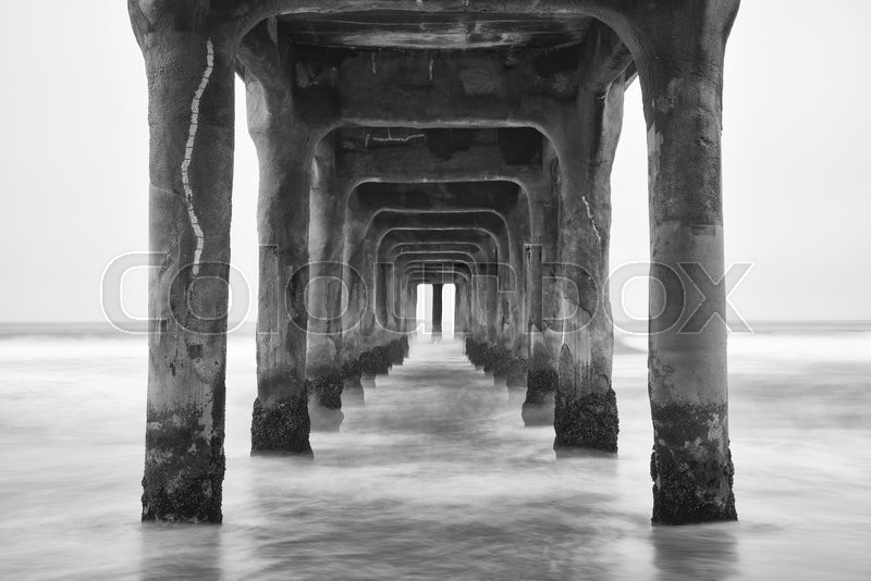 Stock image of 'Under the Pier. Black and white photo Manhattan Beach, California'