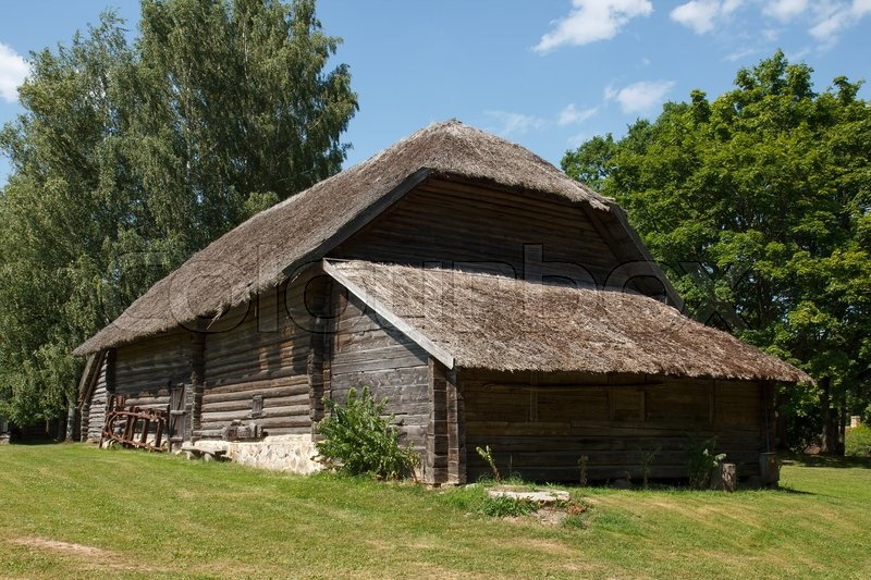 Stock image of 'Traditional Latvian house made out of wood and reeds'