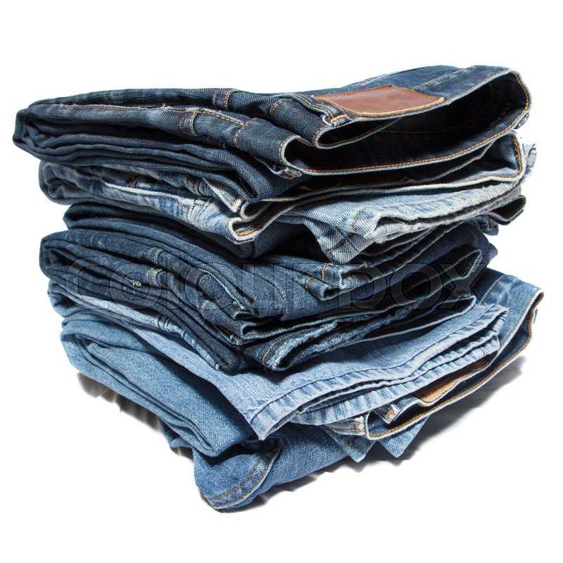 Stock image of 'A bunch of stacked jeans on white background'