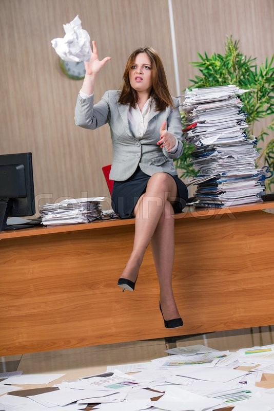 Stock image of 'Businesswoman under stress working in the office'