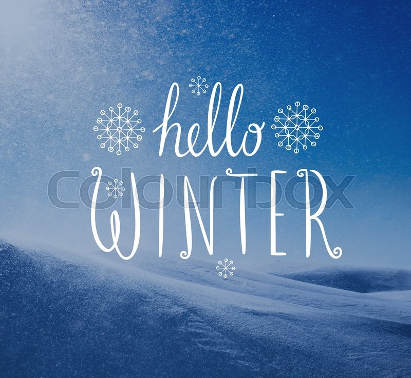 Stock image of 'Photo of snowstorm in sunny day with Hello Winter lettering. Winter holidays card.'