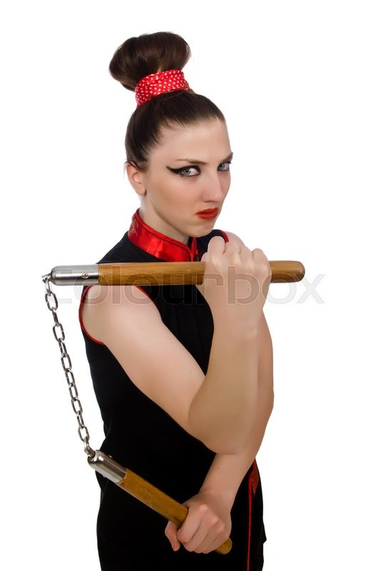 Stock image of 'Funny woman with nunchucks isolated on white'