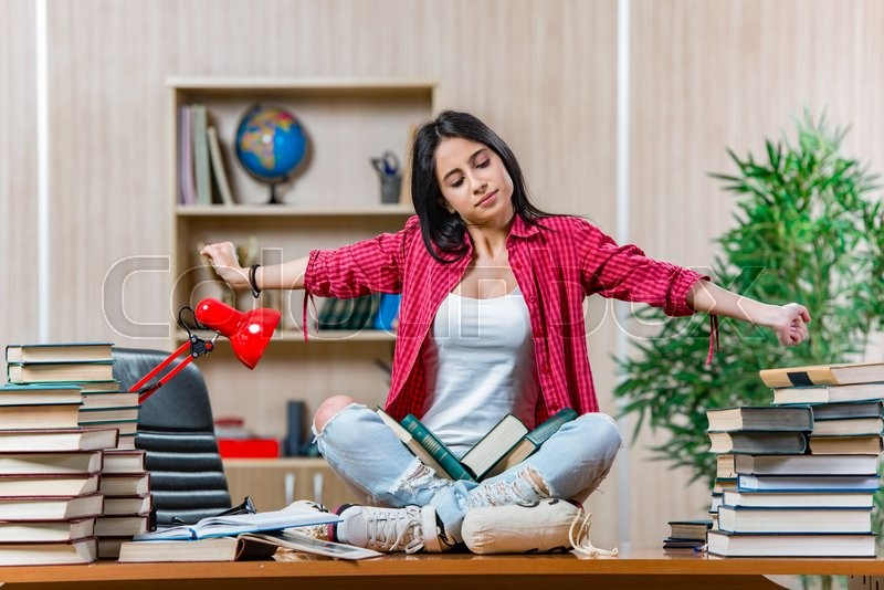 Stock image of 'Young female student preparing for college school exams'