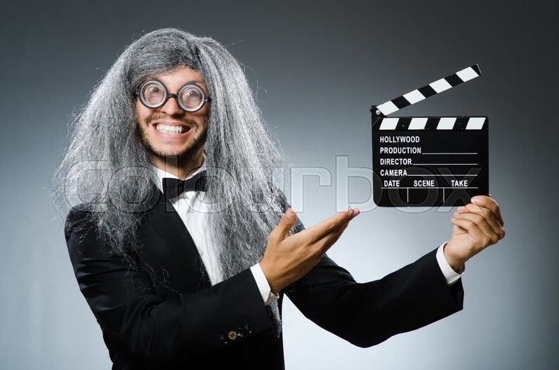 Stock image of 'Funny man with movie clapboard'
