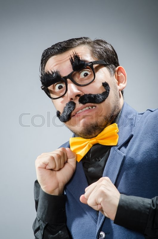 Stock image of 'Funny man against dark background'