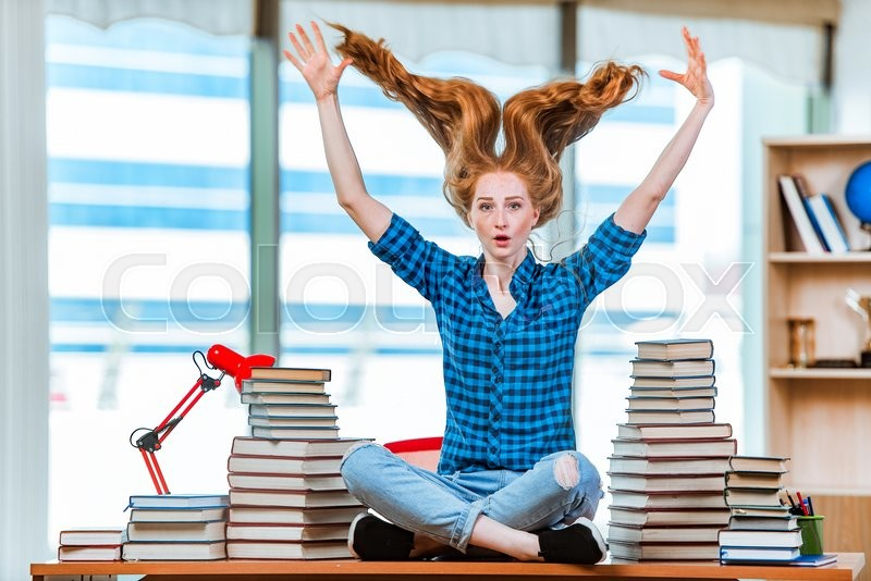Stock image of 'Young female student preparing for exams'