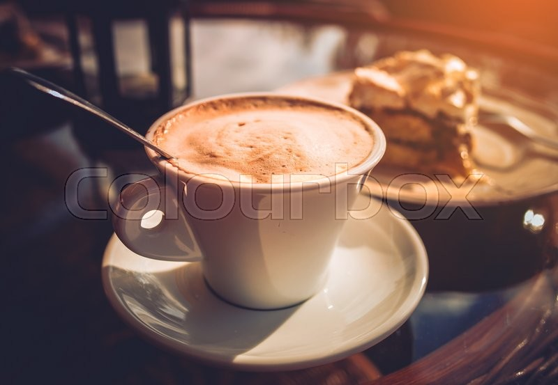 Stock image of 'Cappuccino Coffee and Tasty Cake. Outdoor Garden Table'