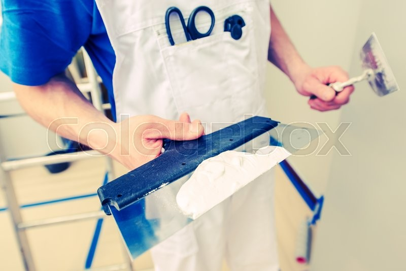 Stock image of 'Drywall Patching Work. Caucasian Men Ready to Patch Drywall Holes.'