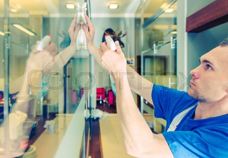 Stock image of 'Glassy Office Interior Cleaning. Caucasian Men Cleaning Glass Elements.'