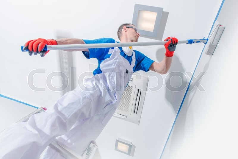 Stock image of 'Interior Painting Business. Professional Room Painter at Work. Walls Painting.'