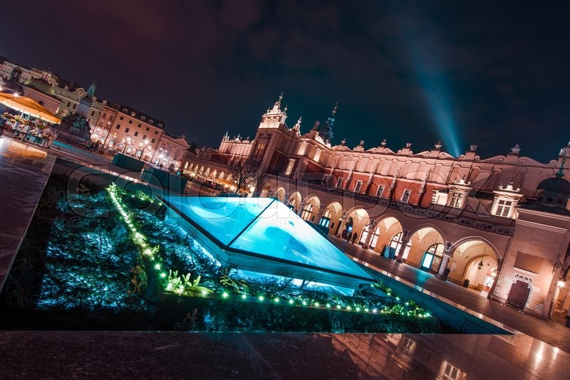 Stock image of 'Magnificent Krakow at Night. Cracow Market Square During Late Night Hours, Poland, Europe. Medieval and Modern Architecture Combined.'